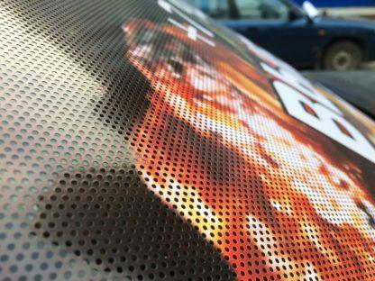 перфорированные наклейки на стекла